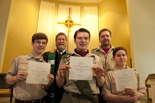 20150208: Acworth, GA: Boy Scouts from Troop 638 (from left) William Jones, 14, Jacob Hall, 14, and Trent Crawford, 14, received their God and Church award during ceremonies at Heritage Presbyterian Church in Acworth on Boy Scout Sunday, February 8, 2015. On the back row (from left) is interim pastor Arch Baker and Scout Master Brad Crawford. The Boy Scouts of America were founded on February 8, 1910.